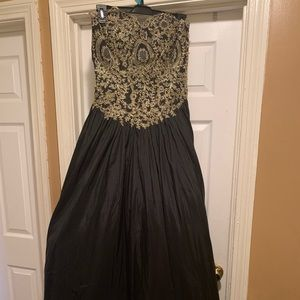 Black prom dress with gold embellishments